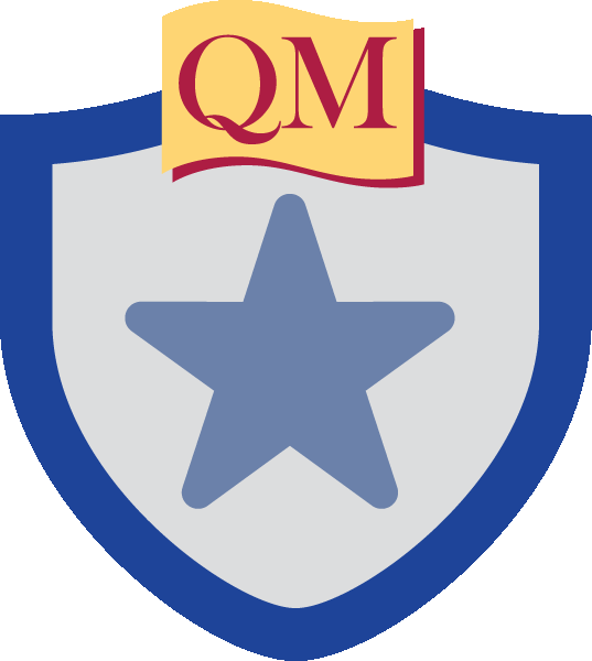 star inside shield with QM at top